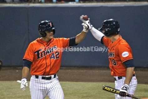 Clay Williamson and Matt Chapman celebrate a run.