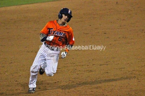 Richy Pedroza prepares to round third base.