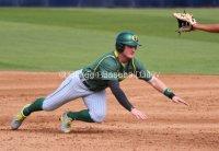 Brett Thomas dives back to first base.