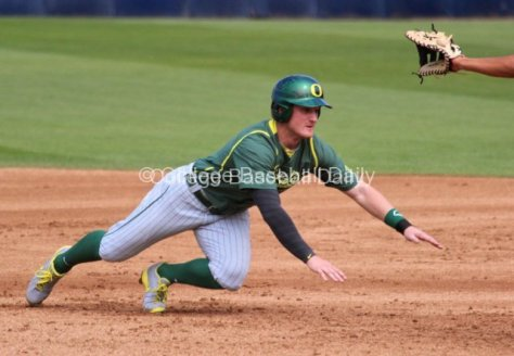 Brett Thomas dives back to first base.