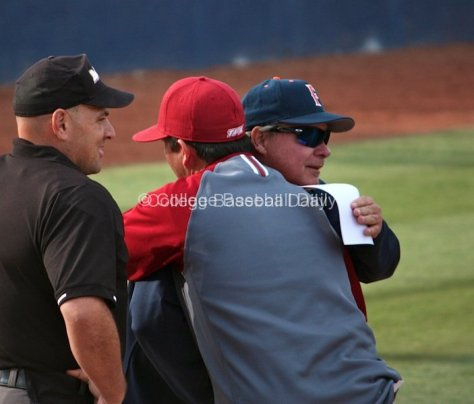 Rich Vanderhook hugs LMU coach Jason Gill