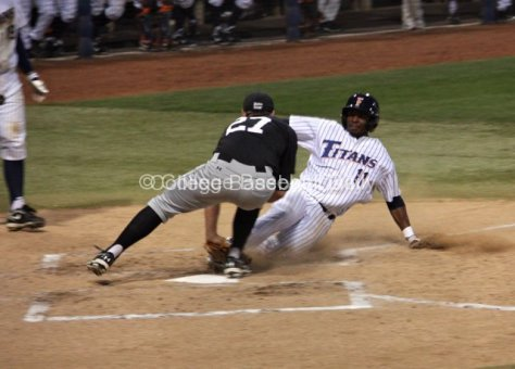 Ivory Thomas is tagged out at the plate.