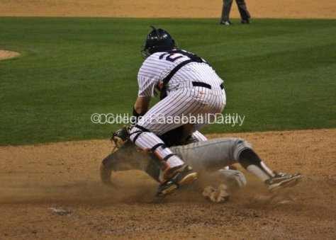 Chad Wallach tries to block the plate.