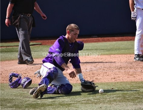 Braden Mattson slides to recover a wild pitch.