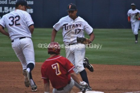 Carlos Lopez beats a sliding Matt Foat to the bag.
