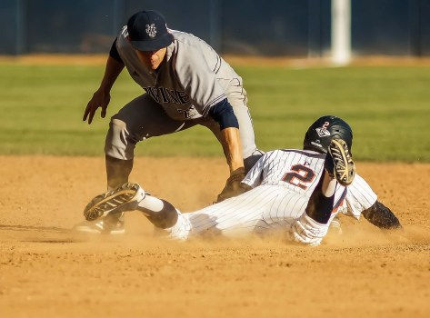 Hutton Moyer dives in with a stolen base. (Photo: Mark Alexander)