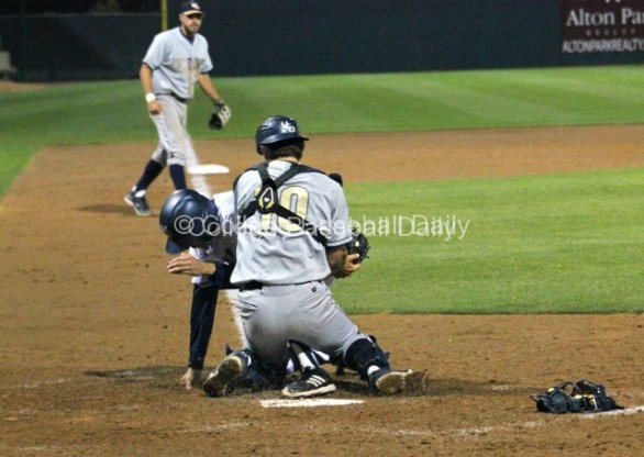 Justin Castro gets his tippy toe in to touch home plate.