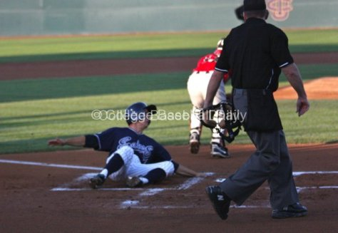 Jordan Fox slides into home.