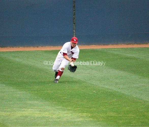 Zac Fujimoto catches a ball on one hop