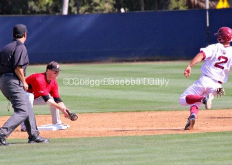 Kyle Attl waits to apply the tag.