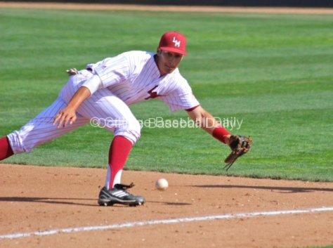 Shon Roe dives at first base.
