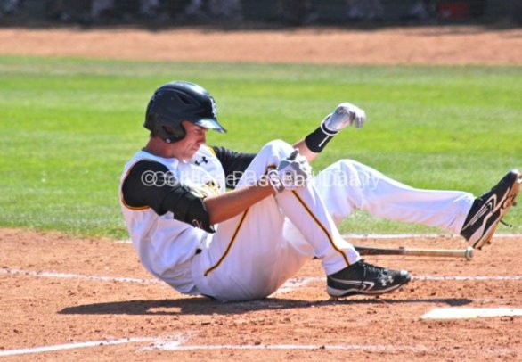 Jeff McNeil goes down after fouling a pitch off his foot.