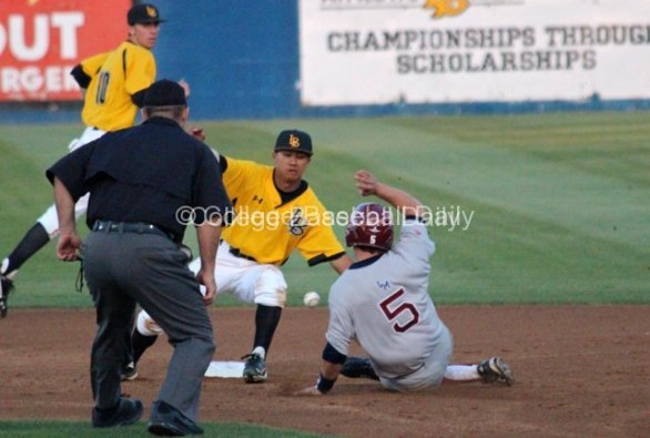 Zac Fujimoto steals second base.