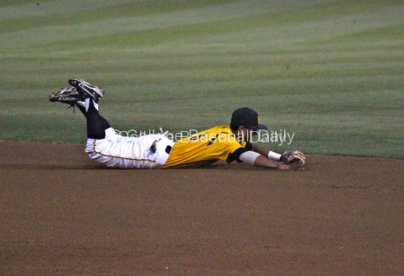 Chaz Meadows makes a diving stop at second base.
