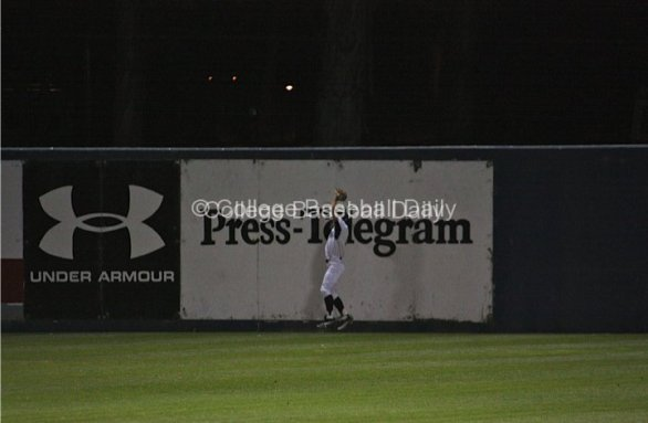 Brennan Metzger catches a ball at the wall.