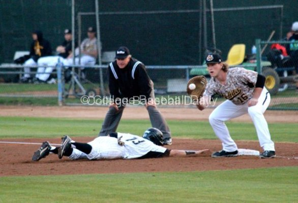 Casey Gillaspie catches a pickoff attempt as Colby Brenner dives in.