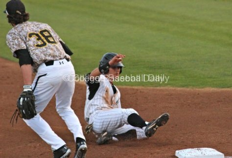 Colby Brenner slides into third.