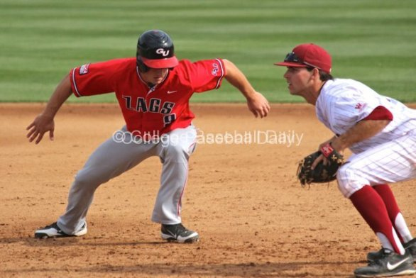 Mitchell Gunsolus dives back to first base.