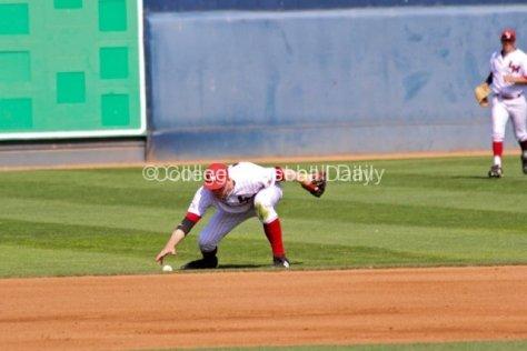Scott Harkin picks the ball up after an error.
