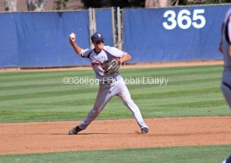 Zach Vincej throws across the diamond.