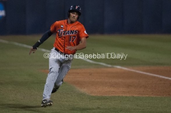 Carlos Lopez rounds third base.