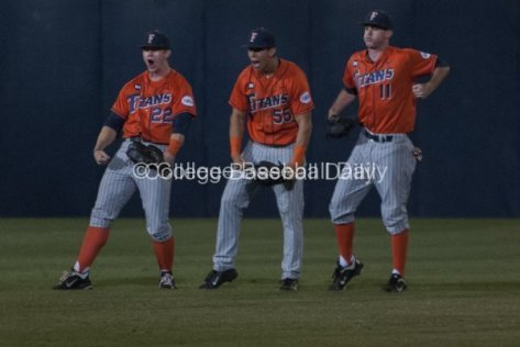 The Cal State Fullerton outfielders celebrate.