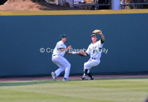 Jordan Ellis and David Armendariz nearly collide trying to catch a fly.