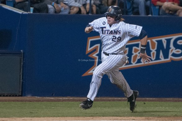 Chad Wallach hustles around third base.