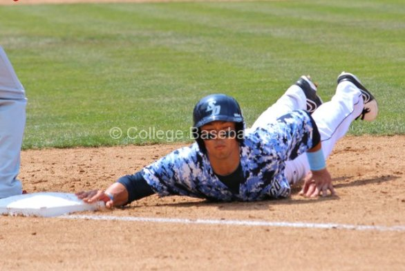 Connor Joe dives back in to first.