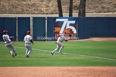 Cody Reine makes a catch down the line in short right field