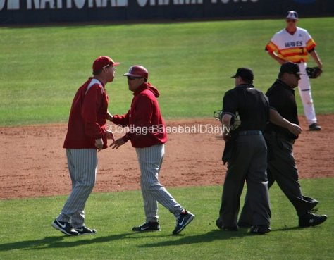 Oklahoma pitching coach Jack Giese yells at the umpires after being ejected from the game