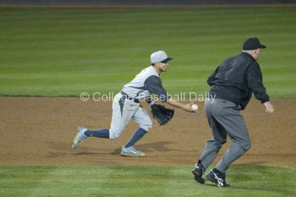 Kevin Minjares starts a double play.