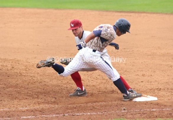 Ranny Lowe lunges for first base.