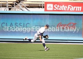 Scott Gottschling makes a running catch down the RF line.