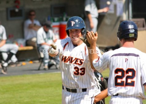 Sam Meyer points to Joe Sever in the dugout after his HR.