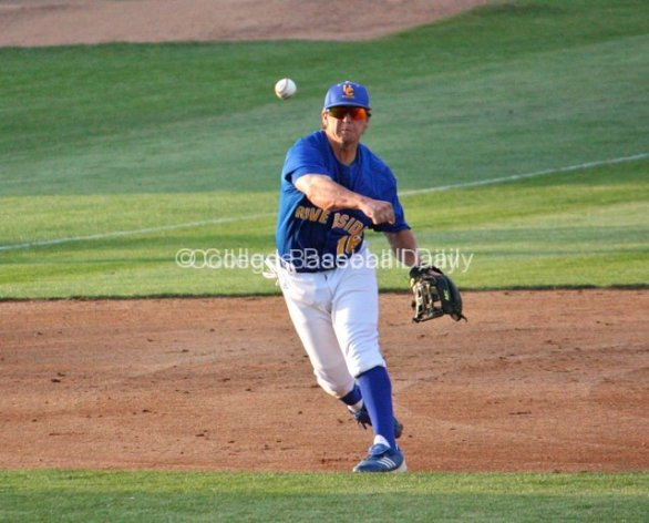 Cody Hough throws out a runner.