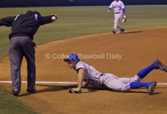 Joey Epperson's diving attempt sends the ball toward the umpire.