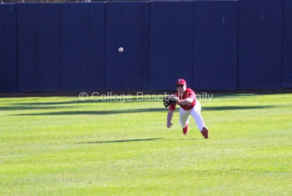 Centerfielder Dan Roland makes a diving catch. (Photo: Shotgun Spratling)