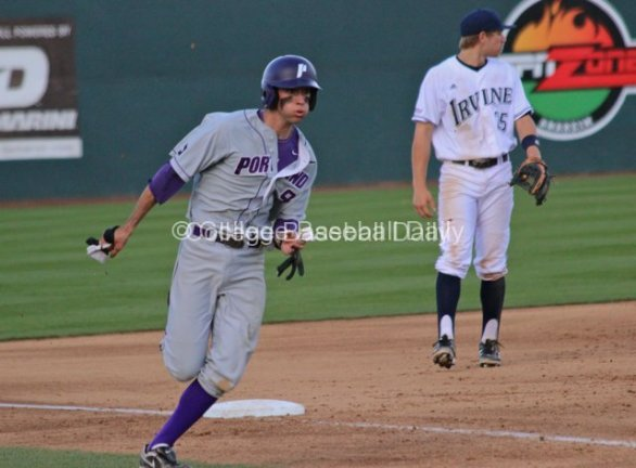 Cody Lenahan rounds third on his way to a run.