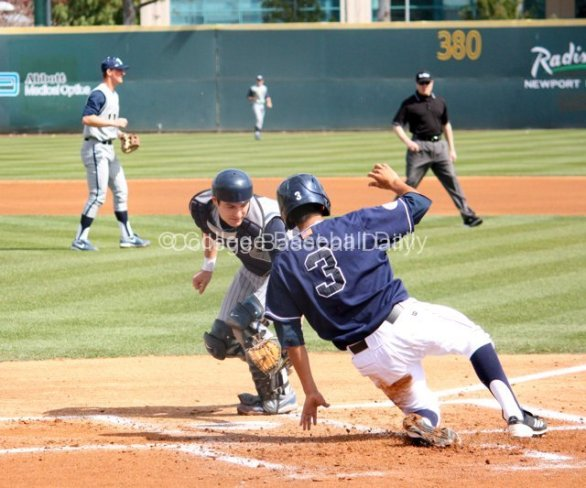 Tommy Reyes slides in before the tag.
