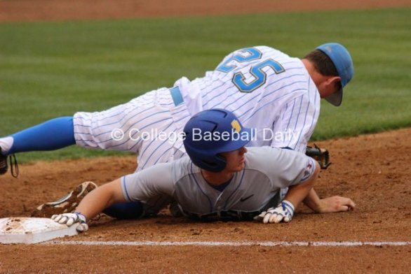 Chris Keck lays on top of a baserunner.