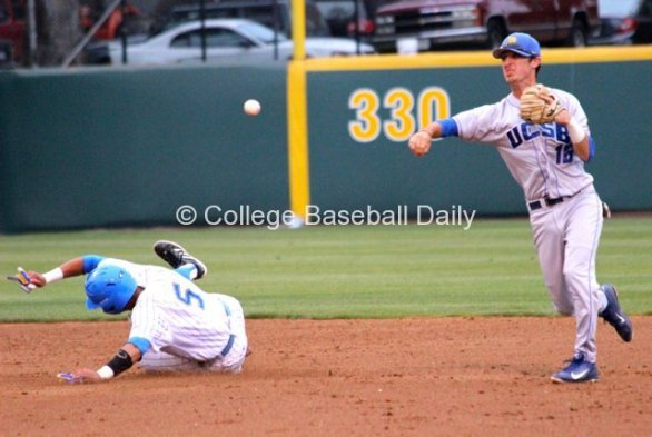 Brandon Trinkwon tries to turn the double play.