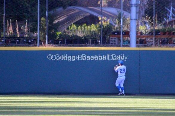 Ty Moore watches Vahn Bozoian's home run.