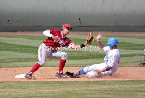 Kenny Diekroeger takes the throw and applies the tag on Jeff Gelalich.