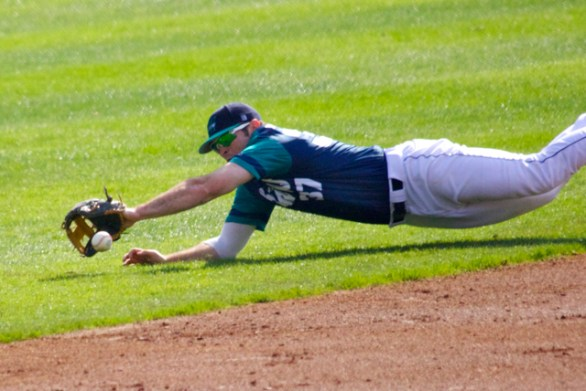 Terence Connelly makes a diving stop in the hole.