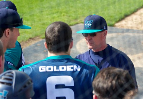 Mark Scalf talks with his hitters.