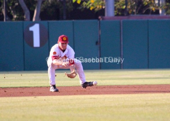 Blake Lacey fields a grounder.