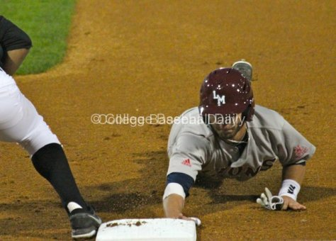 Joey Boney dives back to first.