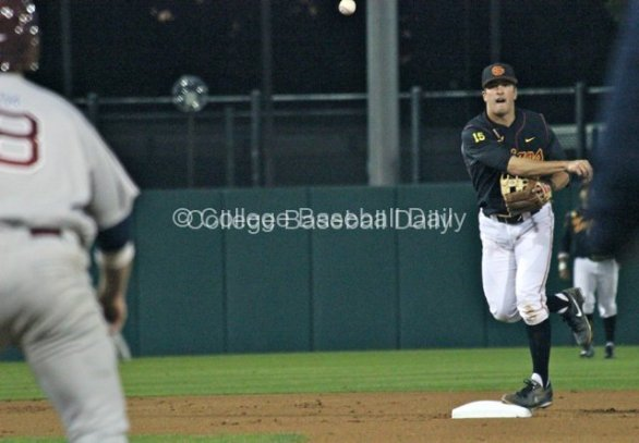James Roberts throws to first for a double play.