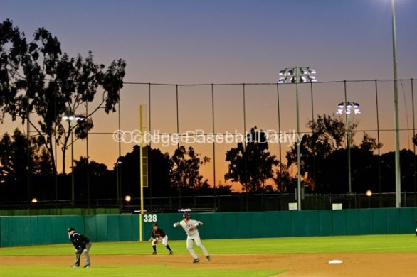 Matt Lowenstein leads off second while the sun sets.